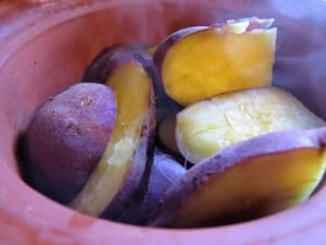 Image of Cooking Potatoes in clay pots